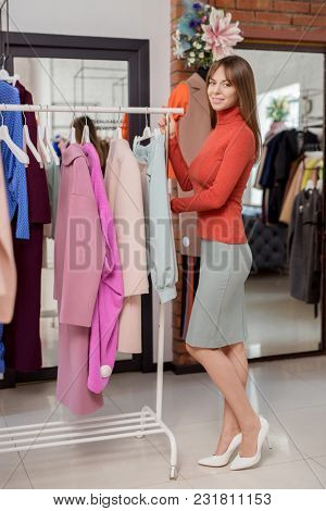Young attractive woman in the shop