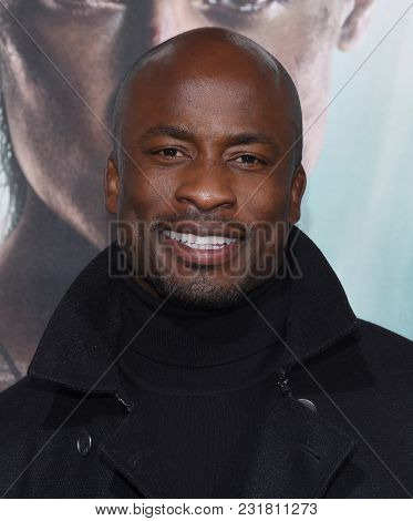 LOS ANGELES - MAR 12:  Akbar Gbaja-Biamila arrives for the 'Tomb Raider' US Premiere on March 12, 2018 in Hollywood, CA
