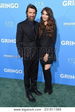 LOS ANGELES - MAR 06:  Sharlto Copley and Tanit Phoenix arrives for the 'Gringo' World Premiere on March 6, 2018 in Los Angeles, CA