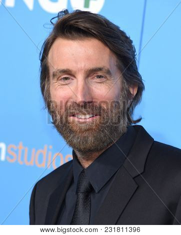 LOS ANGELES - MAR 06:  Sharlto Copley arrives for the 'Gringo' World Premiere on March 6, 2018 in Los Angeles, CA
