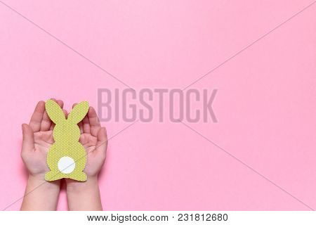 Child Holding In Hands Paper Easter Bunny On Pink Background, Copy Space. Diy Holiday Handicraft Of