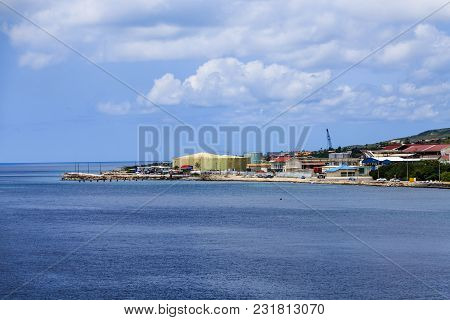 Heavy Industry On Coast Of Curacao By Blue Water