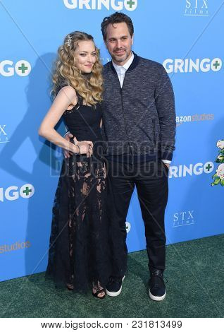 LOS ANGELES - MAR 06:  Amanda Seyfried and Thomas Sadoski arrives for the 'Gringo' World Premiere on March 6, 2018 in Los Angeles, CA