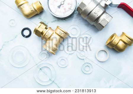 Various Plumbers Tools And Plumbing Materials Including Stainless Steel And Copper Pipe, Elbow Joint