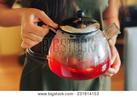 Raspberry Tea Raspberry Tea. A Girl Holding A Teapot With Raspberry Tea
