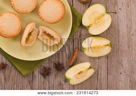 Apple Pies With Cinnamon On Green Dish.