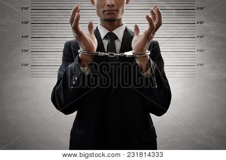 Business Man Wearing Black Suit In Handcuffs