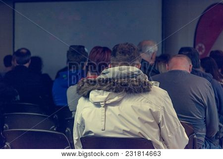 People Listening To Presentation. Audience At Conference.