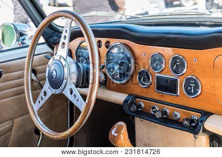 Beit Nir, Israel - March 17, 2018: Triumph Vintage Car Interior - Steering Wheel With Logo And Dashb