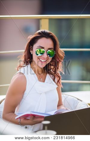 Beautiful Glamorous Sexy Woman Sunglasses Tend To Sit On The Roof Of A Modern Business-lady C Comput