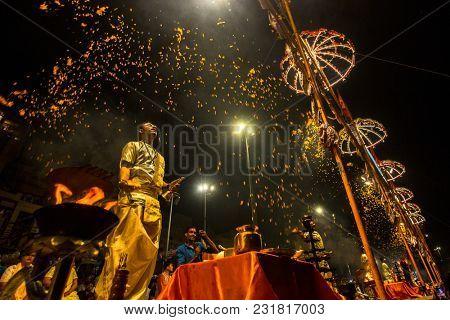 VARANASI, INDIA - MAR 18, 2018: Hindu priest perform Agni Pooja (Sanskrit: Worship of Fire) on Dashashwamedh Ghat - main and oldest ghat of Varanasi located on the Ganges.