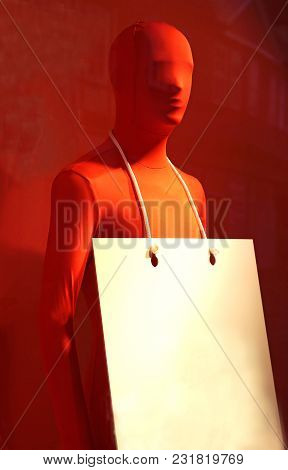 Display Dummy With A Red Morph Suit And A Placard For Text On Red Background