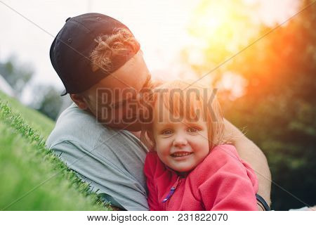 Cheerful Father And Cute Daughter Spending Time Outdoors, Intentional Sun Glare