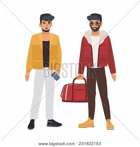 Pair Of Caucasian Men Wearing Casual Clothing And Caps, Holding Phone And Bag, Talking To Each Other