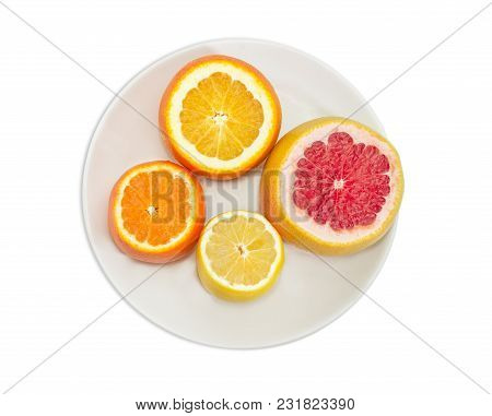 Top View Of The Ripe Red Grapefruit, Orange, Lemon And Mandarin Orange With Cut Off Apexes On The Wh