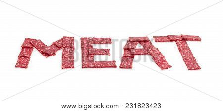 Word Meat Whose Letters Are Laid Out With Sausage Slices Of Rectangular Shape In Perspective At Sele