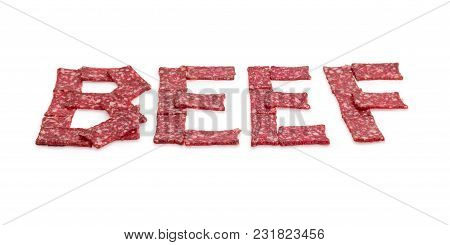 Word Beef Whose Letters Are Laid Out By Sausage Slices Of Rectangular Shape In Perspective At Select