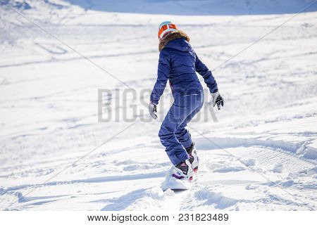 Photo From Back Of Woman Snowboarding On Winter Day