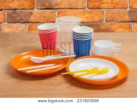 Stacks Of The White And Orange Disposable Plastic Plates Different Sizes With Disposable Plastic For