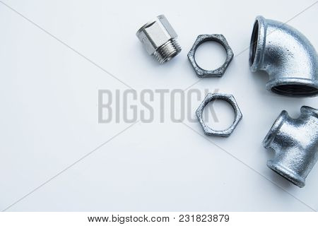 Various Plumbers Tools And Plumbing Materials Including Stainless Steel Pipe, Elbow Joint, Wrench An