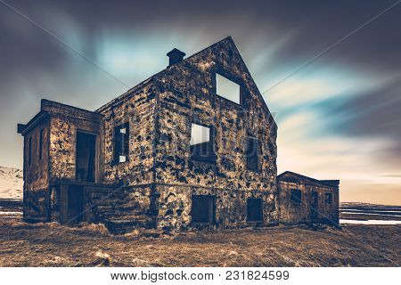 Old damaged house, ruins of building on the wasteland, weathered and abandoned home in Iceland, Scandinavia, Europe poster