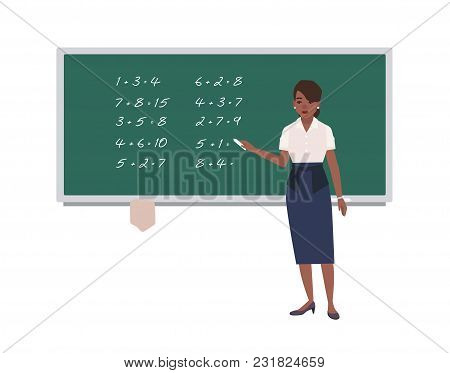 Female Math Teacher Writing Mathematical Expressions On Green Chalkboard. Happy African American Wom