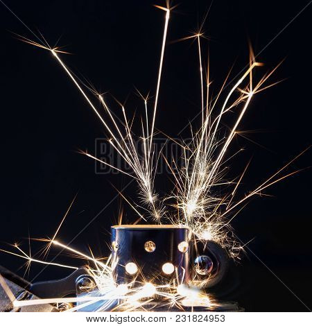 Sparks From The Gasoline Lighter Against A Dark Background