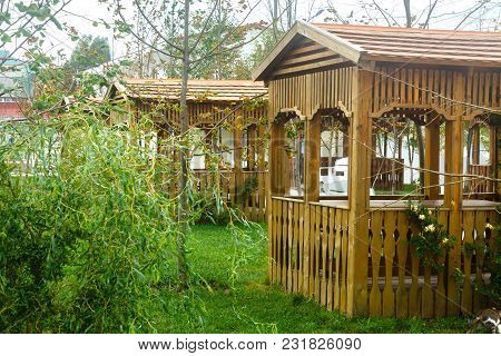 Wooden Empty Gazebo In A Garden. Good Place For Resting On A Summer Day.