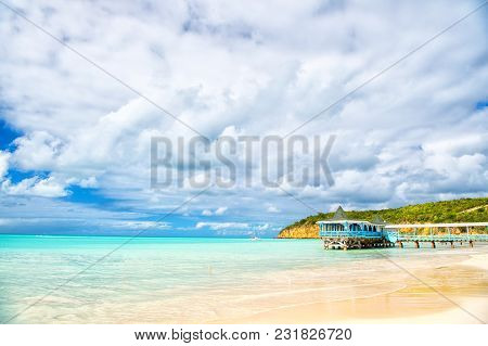 Summer Vacation On Caribbean. Sea Beach With Wooden Shelter In Antigua. Pier In Turquoise Water On C