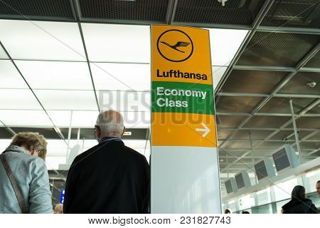 Frankfurt Am Main, Germany - October 11, 2015: Lufthansa Airlines Logo Icon, Economy Class And Direc