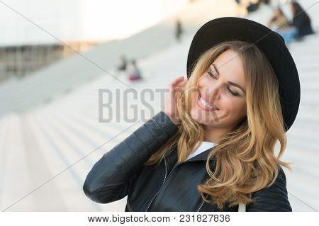 Happy Girl With Long Blond Hair, Hairstyle, In Paris, France. Girl In Black Hat Smile Outdoor, Fashi