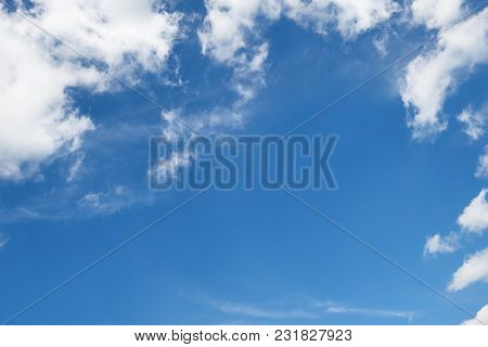 background from bright blue sky with soft cloud at day, frame with place for text