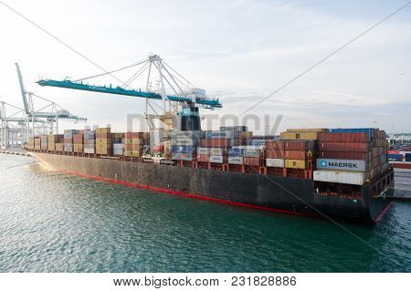 Miami, Usa - March, 18, 2016: Ship With Cargo Containers And Crane In Sea Port. Maritime Container P