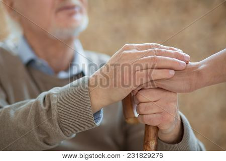 Thank You. Close Up Of Wooden Cane And Senior Male Hands Holding It And Placing Other Hand On Female