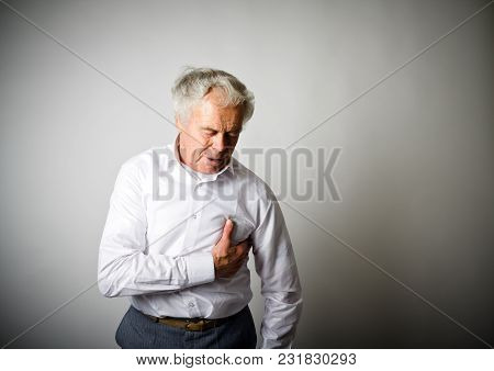 Old Man With Chest Pain Suffering From Heart Attack.