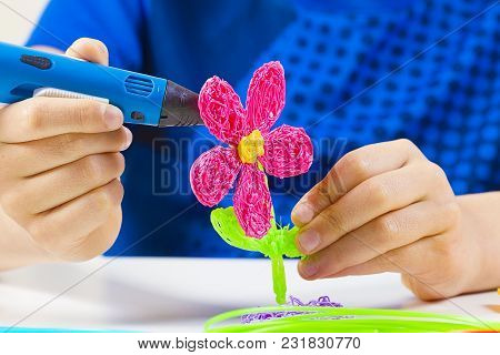 Kid Hands Creating With Blue 3d Printing Pen.