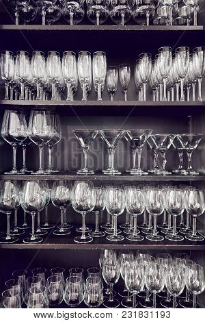 Variety Of Empty Crystal Glasses On A Shelves
