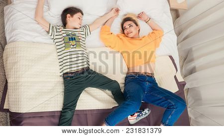 Mother With Son On Bed, Mother And Son Having Fun, Mom And Her Teenager Son Lying On Bed, Mother Wit
