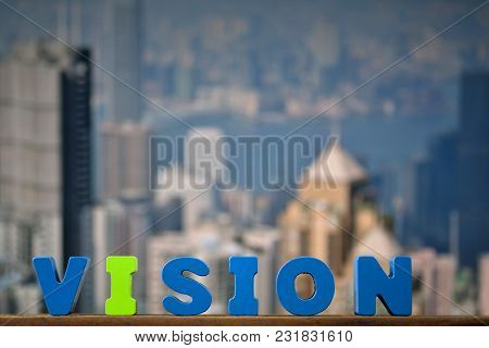 Vision Text On Top Wooden Working Table With City City And Office Building Background, Business And