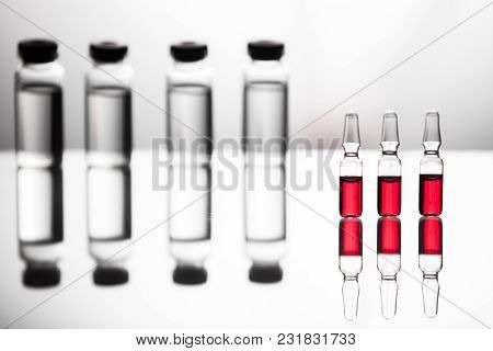Group Object Of Liquid Medicinal Agent In Limpid Glassware In Medical Laboratory