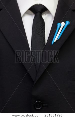 The Detail Of Wedding Suit With Golf Design.golf Tees In The Color Of The Finland   Flag On The Flap