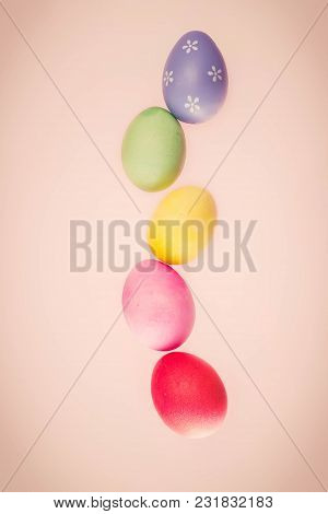 Row Of Flying Easter Eggs On Pink Background, Retro Toned