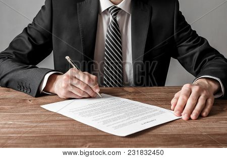 Close Up Business Man Signing Contract Making A Deal, Business And Success Concept