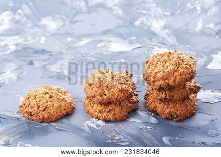 Sweet Cookies With Raisin Arranged In Pile On Light Textured Background, Close-up, Shallow Depth Of
