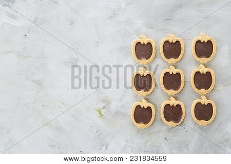 Sweet Apple Shaped Cookies Arranged In Rows On Light Textured Background, Close-up, Shallow Depth Of
