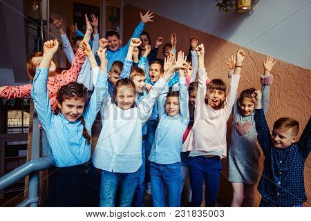 Pupils In A School Hallway Going Down The Stairs After The Lesson