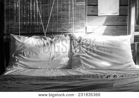 Abstract Black And White Image  Two White Crumpled Pillow On Bed With Sunlight Radiated From Right H