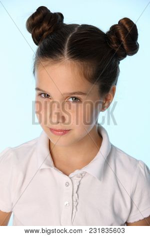 Close-up Portrait Of A Charming Pretty Stylish Young Teenage Schoolgirl. Beautiful Brunette Child Lo