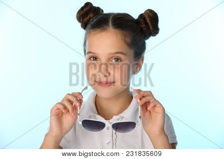 Close-up Portrait Of A Charming Pretty Stylish Young Teenage Schoolgirl. Beautiful Brunette Child Is