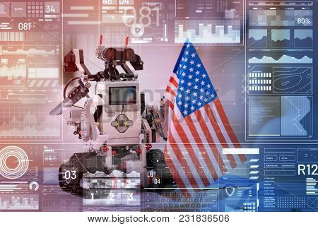 Little Patriot. Cute Little Robot Looking Patriotic While Standing On The Table In A Modern Office A